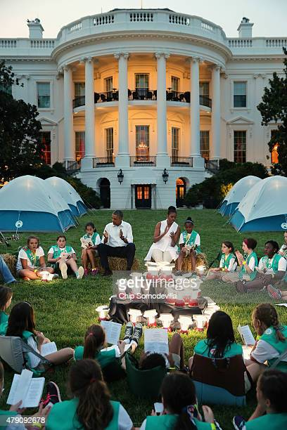 US President Barack Obama and first lady Michelle Obama sit around a pile of batteryoperated lanterns while hosting a group of Girl Scouts from...