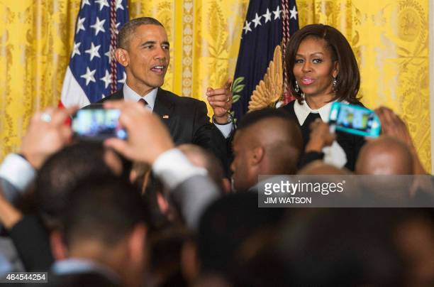 US President Barack Obama and First Lady Michelle Obama speak during a reception celebrating Black History Month at the White House in Washington DC...