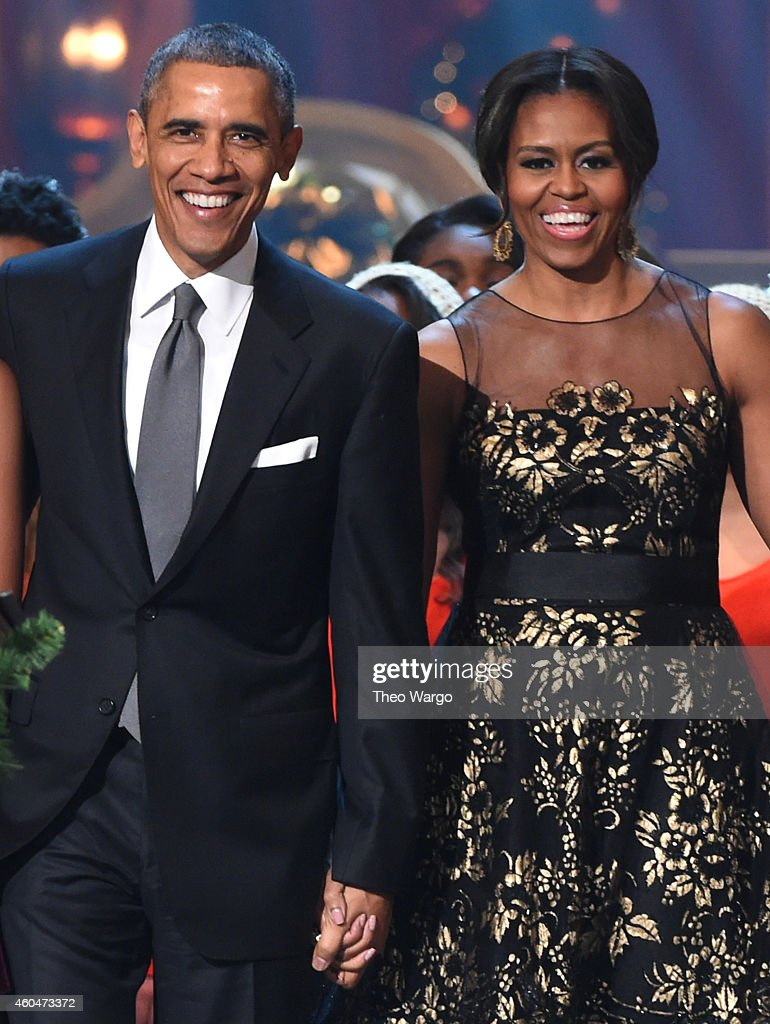 U.S. President <a gi-track='captionPersonalityLinkClicked' href=/galleries/search?phrase=Barack+Obama&family=editorial&specificpeople=203260 ng-click='$event.stopPropagation()'>Barack Obama</a> and First Lady <a gi-track='captionPersonalityLinkClicked' href=/galleries/search?phrase=Michelle+Obama&family=editorial&specificpeople=2528864 ng-click='$event.stopPropagation()'>Michelle Obama</a> speak onstage at TNT Christmas in Washington 2014 at the National Building Museum on December 14, 2014 in Washington, DC. 25248_001_0621.JPG