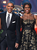S President Barack Obama and First Lady Michelle Obama speak onstage at TNT Christmas in Washington 2014 at the National Building Museum on December...