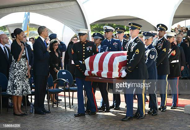 US President Barack Obama and First Lady Michelle Obama stand as the casket passes during the funeral services for the late Senator Daniel Inouye at...