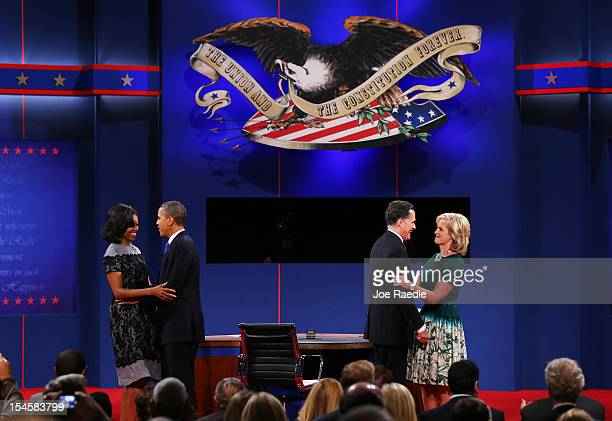 S President Barack Obama and first lady Michelle Obama stand on stage with Republican presidential candidate Mitt Romney and wife Ann Romney after...