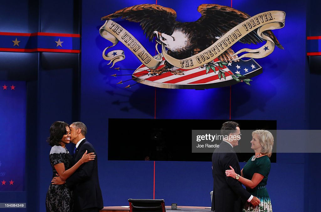 U.S. President <a gi-track='captionPersonalityLinkClicked' href=/galleries/search?phrase=Barack+Obama&family=editorial&specificpeople=203260 ng-click='$event.stopPropagation()'>Barack Obama</a> (2L) and first lady <a gi-track='captionPersonalityLinkClicked' href=/galleries/search?phrase=Michelle+Obama&family=editorial&specificpeople=2528864 ng-click='$event.stopPropagation()'>Michelle Obama</a> (L) stand on stage with Republican presidential candidate <a gi-track='captionPersonalityLinkClicked' href=/galleries/search?phrase=Mitt+Romney&family=editorial&specificpeople=207106 ng-click='$event.stopPropagation()'>Mitt Romney</a> and wife, <a gi-track='captionPersonalityLinkClicked' href=/galleries/search?phrase=Ann+Romney&family=editorial&specificpeople=868004 ng-click='$event.stopPropagation()'>Ann Romney</a> after the debate at the Keith C. and Elaine Johnson Wold Performing Arts Center at Lynn University on October 22, 2012 in Boca Raton, Florida. The focus for the final presidential debate before Election Day on November 6 is foreign policy.