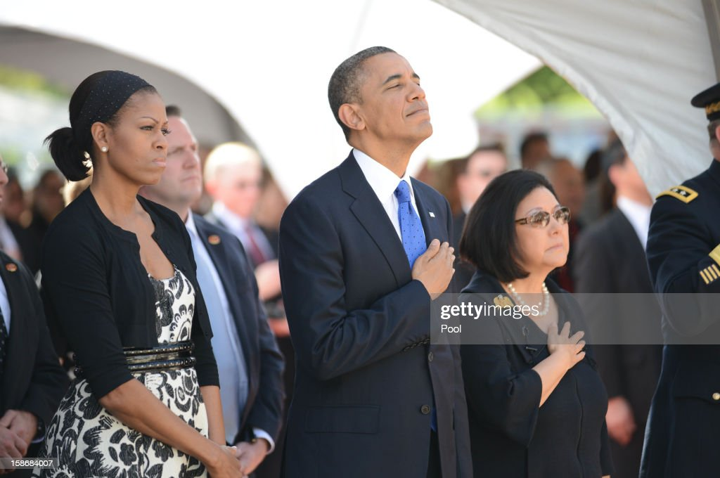 U.S. President Barack Obama and First Lady <a gi-track='captionPersonalityLinkClicked' href=/galleries/search?phrase=Michelle+Obama&family=editorial&specificpeople=2528864 ng-click='$event.stopPropagation()'>Michelle Obama</a> stand with Senator Inouye's wife Irene Hirano during funeral services for the late Senator Daniel Inouye at the National Memorial Cemetery of the Pacific December 23, 2012 in Honolulu, Hawaii. Senator Inouye was a Medal of Honor recipient and a United States Senator since 1963.