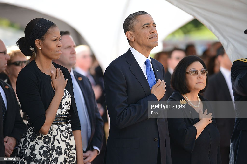 U.S. President <a gi-track='captionPersonalityLinkClicked' href=/galleries/search?phrase=Barack+Obama&family=editorial&specificpeople=203260 ng-click='$event.stopPropagation()'>Barack Obama</a> and first lady <a gi-track='captionPersonalityLinkClicked' href=/galleries/search?phrase=Michelle+Obama&family=editorial&specificpeople=2528864 ng-click='$event.stopPropagation()'>Michelle Obama</a> stand with Senator Daniel Inouye's wife Irene Inouye as taps is played by a bugler during the funeral services for the late Senator Daniel Inouye at the National Memorial Cemetery of the Pacific December 23, 2012 in Honolulu, Hawaii. Senator Inouye was a Medal of Honor recipient and a United States Senator since 1963.