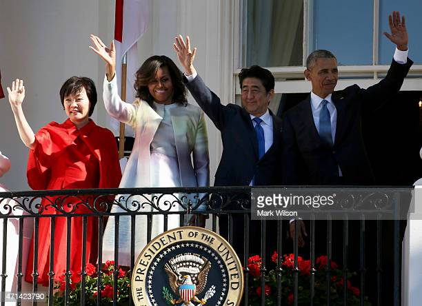 US President Barack Obama and first lady Michelle Obama stand with Japanese Prime Minister Shinzo Abe and his wife Akie Abe during an official...