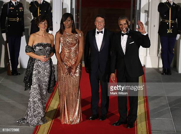S President Barack Obama and first lady Michelle Obama stand with Italian Prime Minister Matteo Renzi and his wife Mrs Agnese Landini upon arrival...