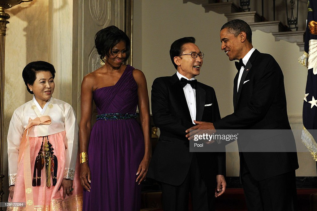 U.S. President <a gi-track='captionPersonalityLinkClicked' href=/galleries/search?phrase=Barack+Obama&family=editorial&specificpeople=203260 ng-click='$event.stopPropagation()'>Barack Obama</a> (R) and first lady <a gi-track='captionPersonalityLinkClicked' href=/galleries/search?phrase=Michelle+Obama&family=editorial&specificpeople=2528864 ng-click='$event.stopPropagation()'>Michelle Obama</a> (2L) stand with South Korean President Lee Myung-bak (2R) and Lee's wife Kim Yoon-ok in the Cross Hall as they arrive for a State Dinner at the White House October 13, 2011 in Washington, DC. The State Visit comes only a day after Congress passed a free trade agreement with South Korea.