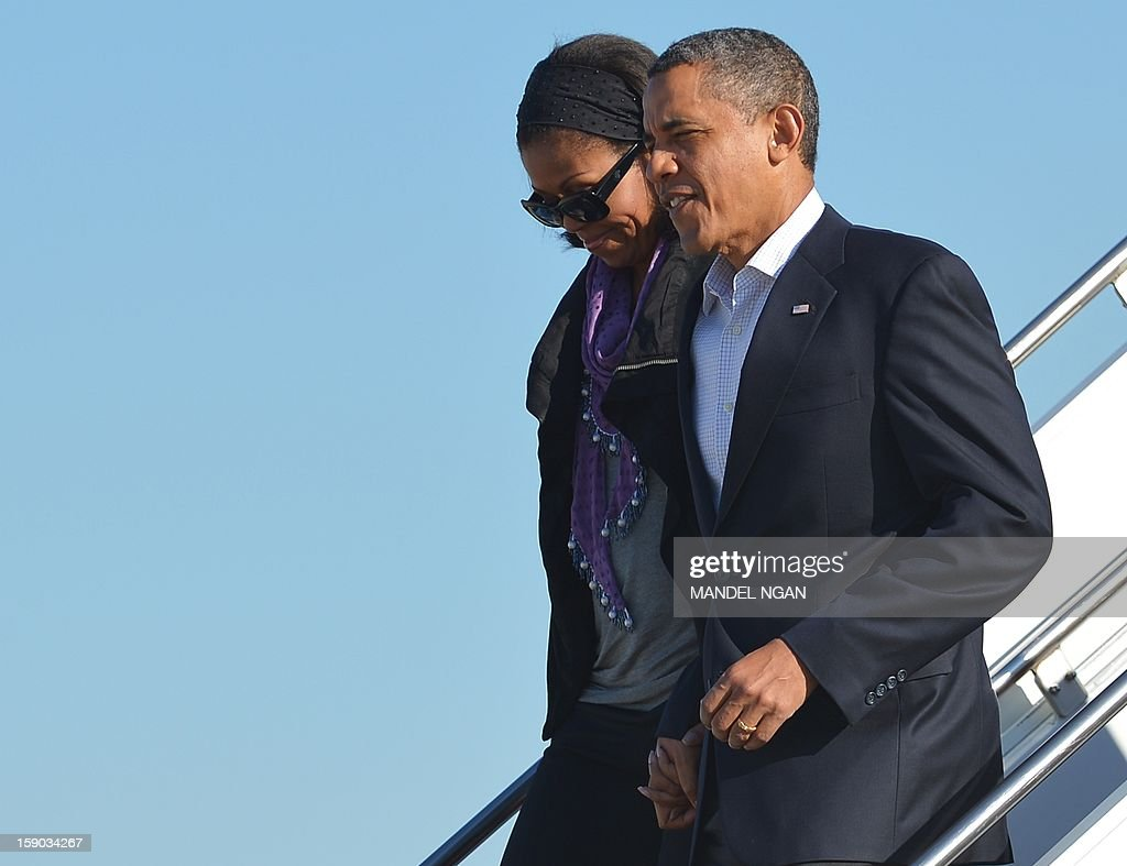 US President Barack Obama and First Lady Michelle Obama step off Air Force One on January 6, 2013 upon arrival at Andrews Air Force Base in Maryland. Obama returned to Washington after finishing his vacation in Hawaii. AFP PHOTO/Mandel NGAN