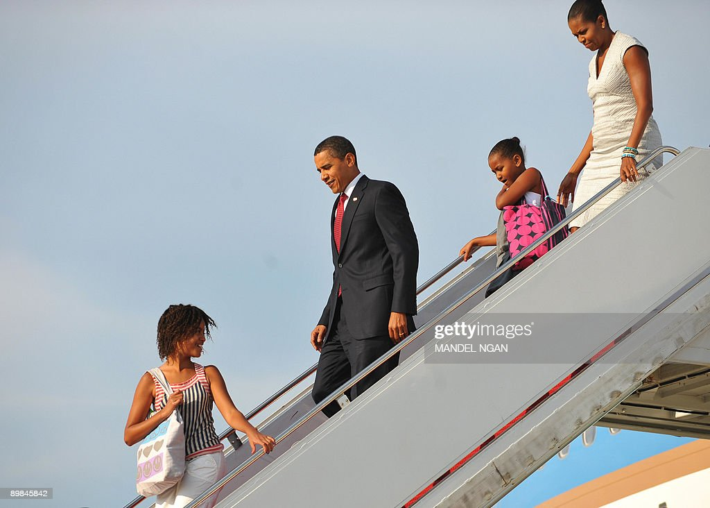 US President <a gi-track='captionPersonalityLinkClicked' href=/galleries/search?phrase=Barack+Obama&family=editorial&specificpeople=203260 ng-click='$event.stopPropagation()'>Barack Obama</a> and First Lady <a gi-track='captionPersonalityLinkClicked' href=/galleries/search?phrase=Michelle+Obama&family=editorial&specificpeople=2528864 ng-click='$event.stopPropagation()'>Michelle Obama</a> step off Air Force One with their daughters Malia (L) and Sasha (2nd R) upon arrival at Andrews Air Force Base in Maryland. Obama returned to Washington after a weekend visit to Montana, Wyoming, Colorado and Arizona. AFP PHOTO/Mandel NGAN