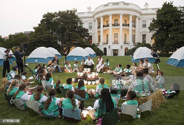 US President Barack Obama and First Lady Michelle Obama talk with Girl Scouts that are camping overnight on the South Lawn of the White House in...
