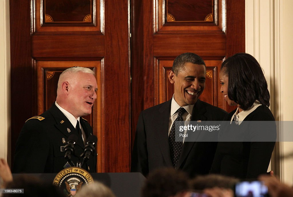 U.S. President <a gi-track='captionPersonalityLinkClicked' href=/galleries/search?phrase=Barack+Obama&family=editorial&specificpeople=203260 ng-click='$event.stopPropagation()'>Barack Obama</a> (C) and first lady <a gi-track='captionPersonalityLinkClicked' href=/galleries/search?phrase=Michelle+Obama&family=editorial&specificpeople=2528864 ng-click='$event.stopPropagation()'>Michelle Obama</a> talk with Rabbi Larry Bazer following a Hanukkah reception in the Grand Foyer of the White House December 13, 2012 in Washington DC. The celebration included the lighting of candles in a 90-year-old menorah from a temple in Long Island, New York that was heavily flooded during Superstorm Sandy.