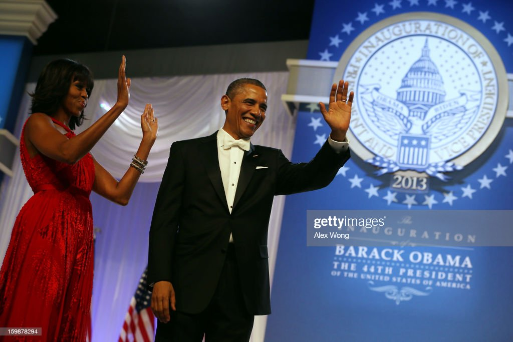 U.S. President Barack Obama and first lady Michelle Obama thank supporters during the Commander in Chief Inaugural Ball at the Walter E. Washington Convention Center on January 21, 2013 in Washington, DC. President Obama was sworn in for his second term earlier in the day.