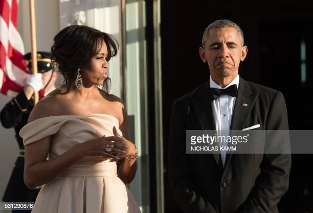 President Barack Obama and First Lady Michelle Obama wait for Nordic leaders to arrive for a state dinner at the White House in Washington DC on May...
