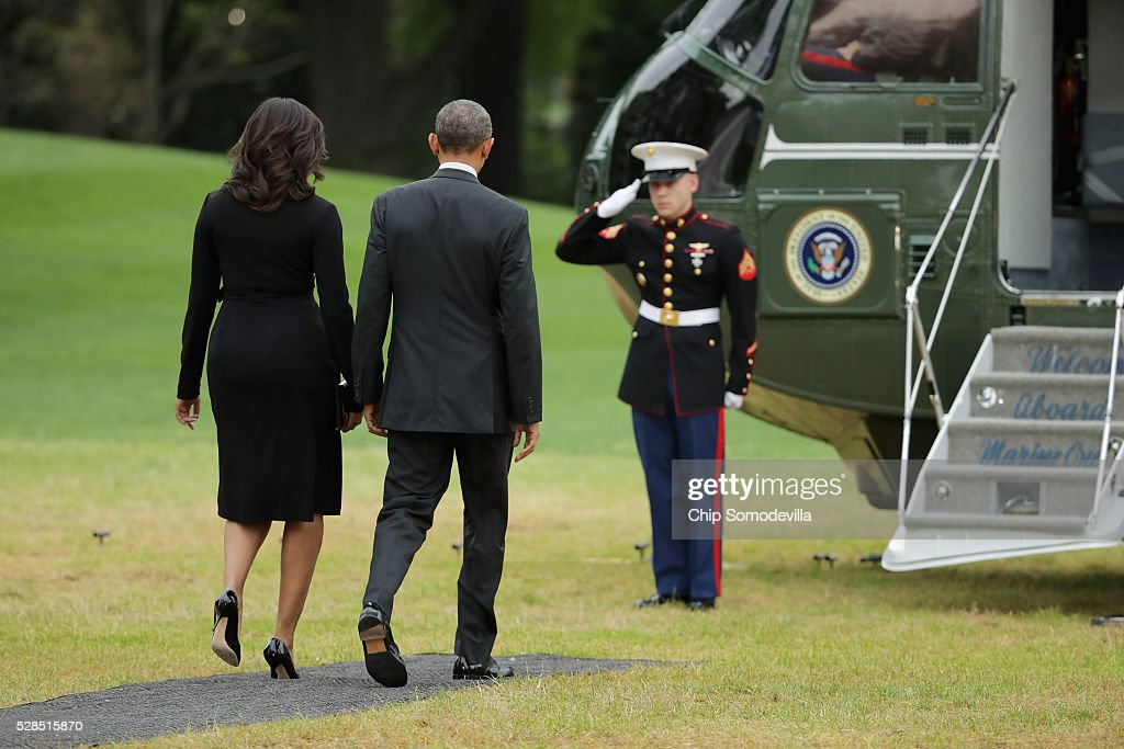 President Barack Obama and first lady Michelle Obama walk across the South Lawn before departing the White House May 5, 2016 in Washington, DC. The Obamas will be hosting a comedy show celebrating Military Appreciation Month, the fifth anniversary of Joining Forces, and the 75th anniversary of the USO at Joint Base Andrews.