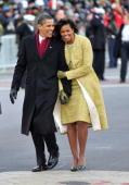 President Barack Obama and first lady Michelle Obama walk in the Inaugural Parade on January 20 2009 in Washington DC Obama was sworn in as the 44th...