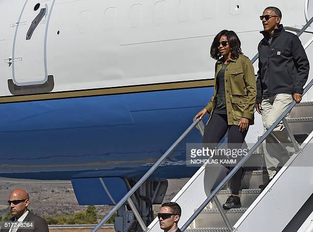 US President Barack Obama and First Lady Michelle Obama walk off Air Force One in Bariloche Argentina on March 24 2016 President Barack Obama paid...