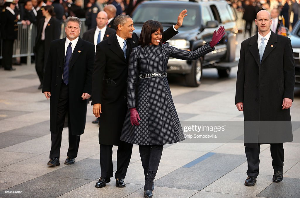 U.S. President Barack Obama and First lady Michelle Obama walk the route as the presidential inaugural parade winds through the nation's capital January 21, 2013 in Washington, DC. Barack Obama was re-elected for a second term as President of the United States.