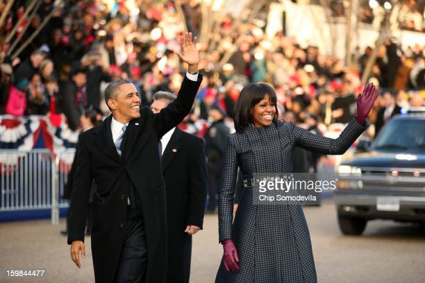 S President Barack Obama and first lady Michelle Obama walk the route as the presidential inaugural parade winds through the nation's capital January...