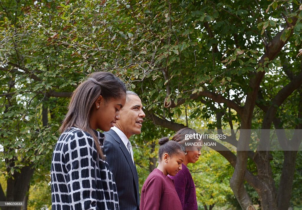 US President Barack Obama and First Lady Michelle Obama walk with daughters Malia (L) and Sasha (2nd R) from the White House, across Lafayette Park to Saint John's Episcopal Church for Sunday services on October 27, 2013 in Washington, DC. AFP PHOTO/Mandel NGAN