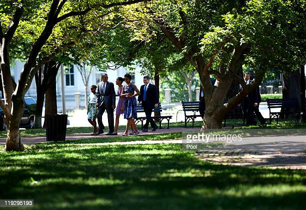 US President Barack Obama and first lady Michelle Obama walk with their daughters Sasha and Malia through Lafayette Square from the White House to St...