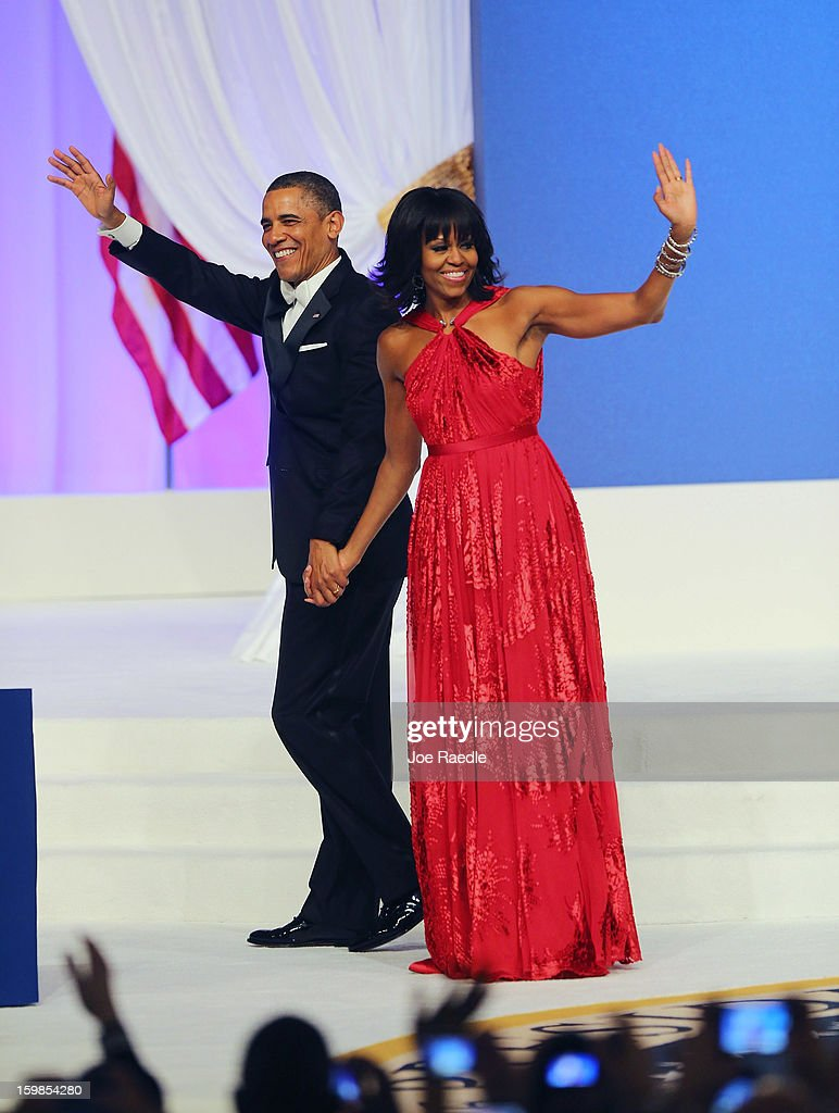 U.S. President <a gi-track='captionPersonalityLinkClicked' href=/galleries/search?phrase=Barack+Obama&family=editorial&specificpeople=203260 ng-click='$event.stopPropagation()'>Barack Obama</a> and first lady <a gi-track='captionPersonalityLinkClicked' href=/galleries/search?phrase=Michelle+Obama&family=editorial&specificpeople=2528864 ng-click='$event.stopPropagation()'>Michelle Obama</a> wave after dancing during the Commander-In-Chief's Inaugural Ball January 21, 2013 in Washington, DC. Obama was sworn in today for his second term in a public ceremonial swearing in..