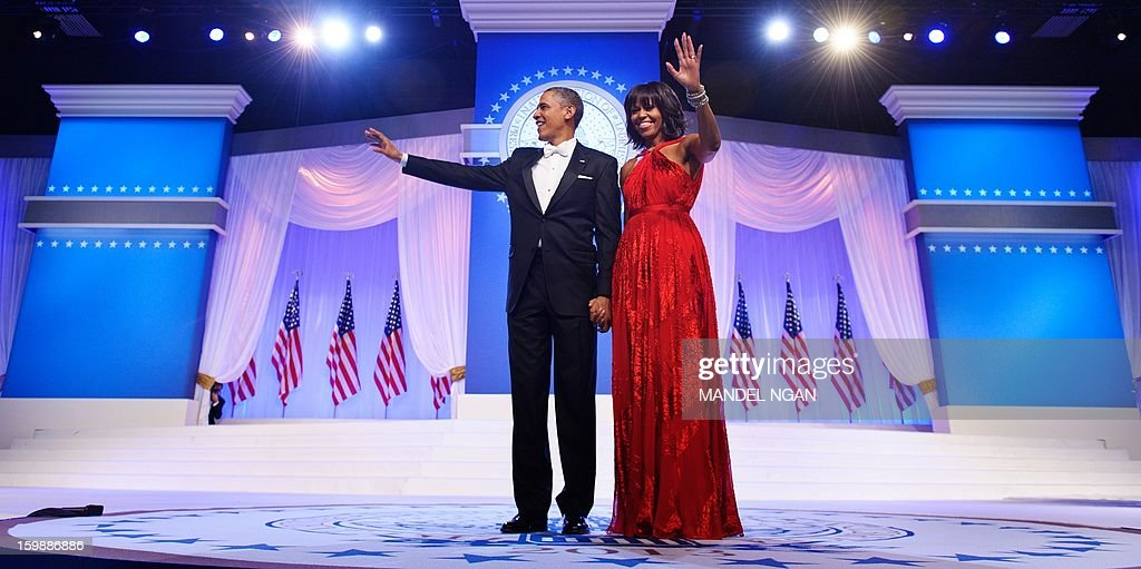 US President Barack Obama and First Lady Michelle Obama wave after attending the Inaugural Ball at the Walter E. Washington Convention Center on January 21, 2013 in Washington, DC. AFP PHOTO/MANDEL NGAN