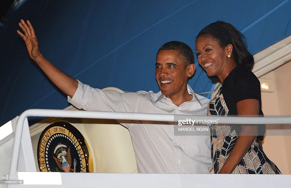 US President Barack Obama and First Lady <a gi-track='captionPersonalityLinkClicked' href=/galleries/search?phrase=Michelle+Obama&family=editorial&specificpeople=2528864 ng-click='$event.stopPropagation()'>Michelle Obama</a> (R) wave as they board Air Force One on January 5, 2013 upon departure from Hickam Air Force Base in Honolulu, Hawaii. Obama was to return to Washington, DC after vacationing in Hawaii. AFP PHOTO / Mandel NGAN