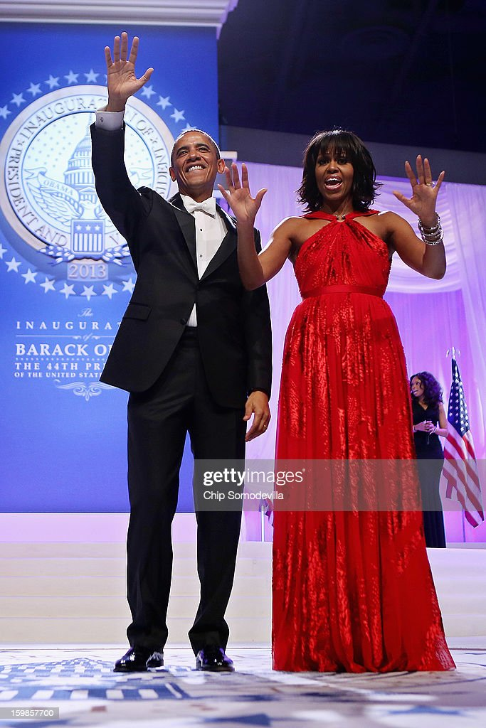 U.S. President Barack Obama and first lady Michelle Obama wave goodbye after attending the Comander-in-Chief's Inaugural Ball at the Walter Washington Convention Center January 21, 2013 in Washington, DC. Obama was sworn-in for his second term of office earlier in the day.