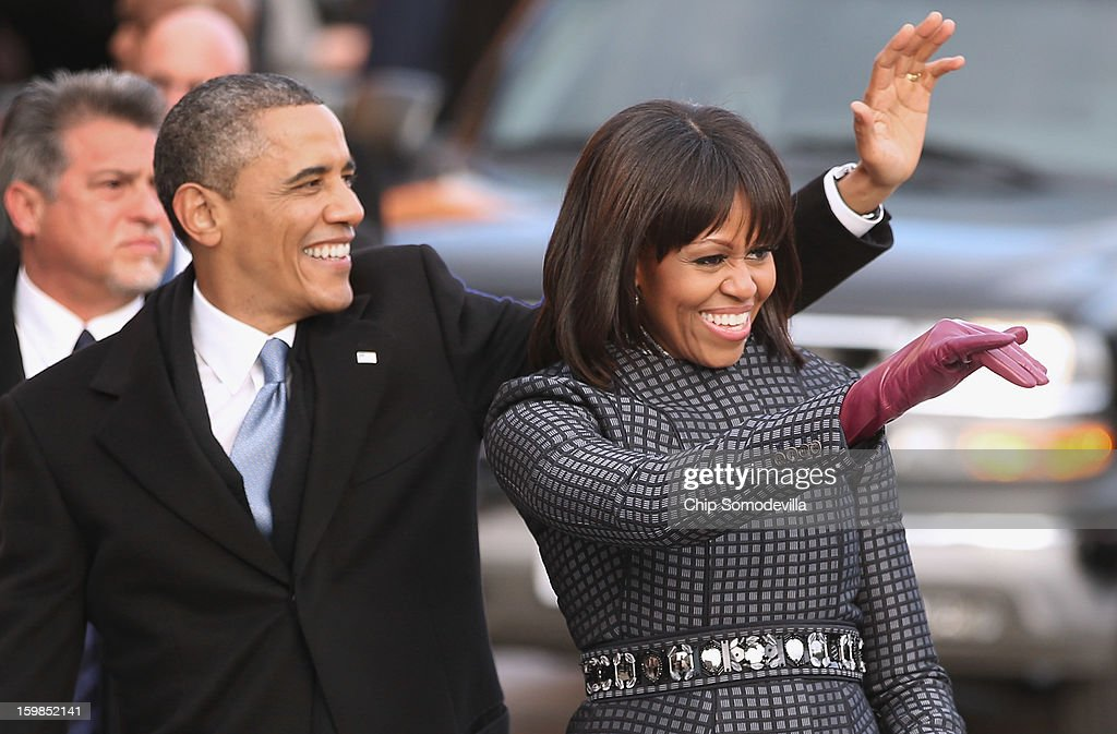 U.S. President <a gi-track='captionPersonalityLinkClicked' href=/galleries/search?phrase=Barack+Obama&family=editorial&specificpeople=203260 ng-click='$event.stopPropagation()'>Barack Obama</a> and first lady <a gi-track='captionPersonalityLinkClicked' href=/galleries/search?phrase=Michelle+Obama&family=editorial&specificpeople=2528864 ng-click='$event.stopPropagation()'>Michelle Obama</a> wave to supporters as they walk the inaugural parade route down Pennsylvania Avenue January 21, 2013 in Washington, DC. President Obama took the oath of office earlier in the day during a ceremony on the west front of the U.S. Capitol.