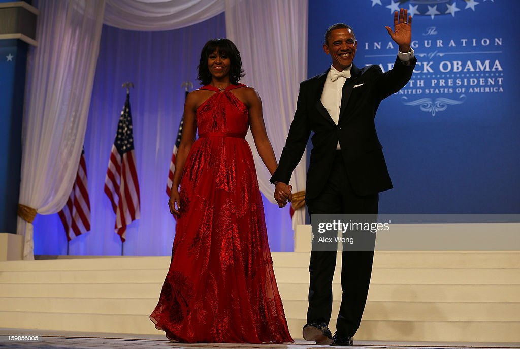 U.S. President Barack Obama (R) and first lady Michelle Obama wave to the crowd during the Commander in Chief Inaugural Ball at the Walter E. Washington Convention Center on January 21, 2013 in Washington, DC. Obama was sworn in for his second term earlier in the day.