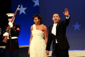 S President Barack Obama and first lady Michelle Obama wave to the crowd during the Home States Inaugural Ball January 20 2009 in Washington DC Obama...