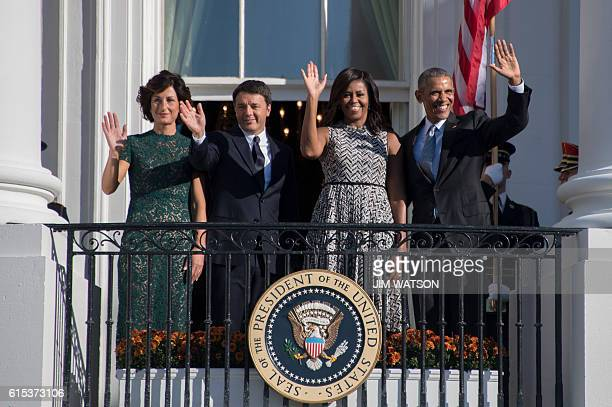 US President Barack Obama and First Lady Michelle Obama wave with Italian Prime Minister Matteo Renzi and his wife Mrs Agnese Landini from the...