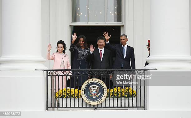 President Barack Obama and First Lady Michelle Obama wave with Chinese President Xi Jinping and First Lady Peng Liyuan at the White House September...