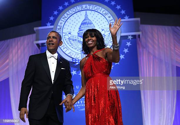 S President Barack Obama and first lady Michelle Obama waves to supporters during the Inaugural Ball January 21 2013 at Walter E Washington...