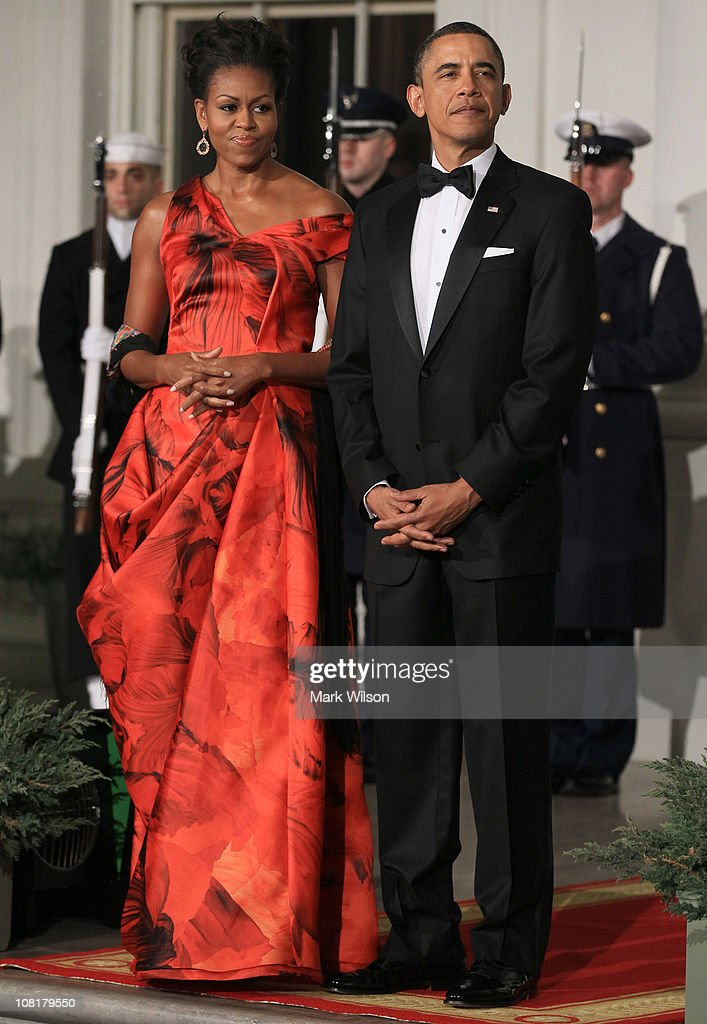 U.S. President <a gi-track='captionPersonalityLinkClicked' href=/galleries/search?phrase=Barack+Obama&family=editorial&specificpeople=203260 ng-click='$event.stopPropagation()'>Barack Obama</a> (R) and first lady <a gi-track='captionPersonalityLinkClicked' href=/galleries/search?phrase=Michelle+Obama&family=editorial&specificpeople=2528864 ng-click='$event.stopPropagation()'>Michelle Obama</a> (L) welcome Chinese President Hu Jintao for a State dinner at the White House January 19, 2011 in Washington, DC. Obama and Hu met in the Oval Office earlier in the day.