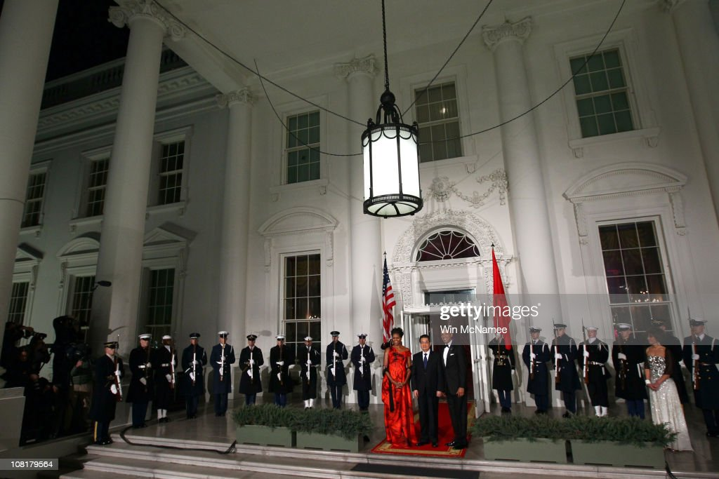 U.S. President <a gi-track='captionPersonalityLinkClicked' href=/galleries/search?phrase=Barack+Obama&family=editorial&specificpeople=203260 ng-click='$event.stopPropagation()'>Barack Obama</a> and first lady <a gi-track='captionPersonalityLinkClicked' href=/galleries/search?phrase=Michelle+Obama&family=editorial&specificpeople=2528864 ng-click='$event.stopPropagation()'>Michelle Obama</a> welcome Chinese President <a gi-track='captionPersonalityLinkClicked' href=/galleries/search?phrase=Hu+Jintao&family=editorial&specificpeople=203109 ng-click='$event.stopPropagation()'>Hu Jintao</a> for a State dinner at the White House January 19, 2011 in Washington, DC. Obama and Hu met in the Oval Office earlier in the day. Liu Yongqing