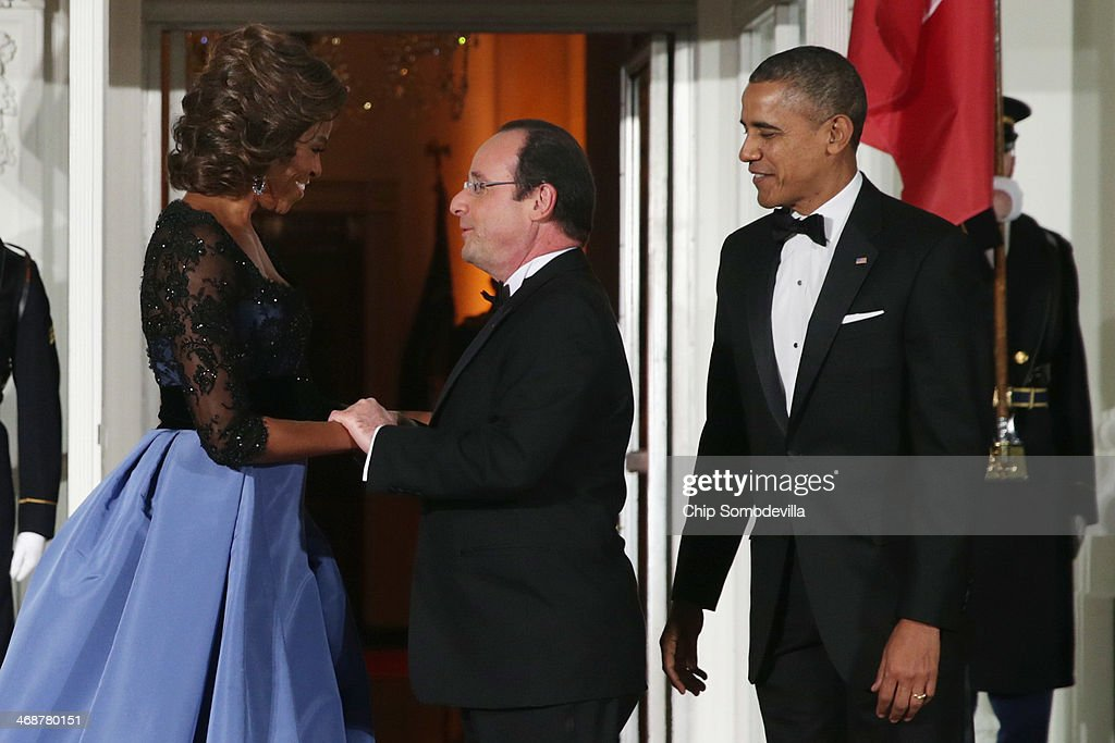 U.S. President <a gi-track='captionPersonalityLinkClicked' href=/galleries/search?phrase=Barack+Obama&family=editorial&specificpeople=203260 ng-click='$event.stopPropagation()'>Barack Obama</a> (R) and first lady <a gi-track='captionPersonalityLinkClicked' href=/galleries/search?phrase=Michelle+Obama&family=editorial&specificpeople=2528864 ng-click='$event.stopPropagation()'>Michelle Obama</a> welcome French President Francois Hollande (C) during an official State Visit on the North Portico of the White House February 11, 2014 in Washington, DC. The two leaders held bilateral meetings, a joint press conference and will attend an official State Dinner.