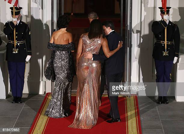 S President Barack Obama and first lady Michelle Obama welcome Italian Prime Minister Matteo Renzi and his wife Mrs Agnese Landini upon their arrival...