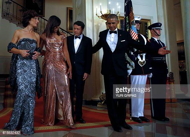 US President Barack Obama and First lady Michelle Obama welcome Italian Prime Minister Matteo Renzi and his wife Agnese Landini for the State Dinner...