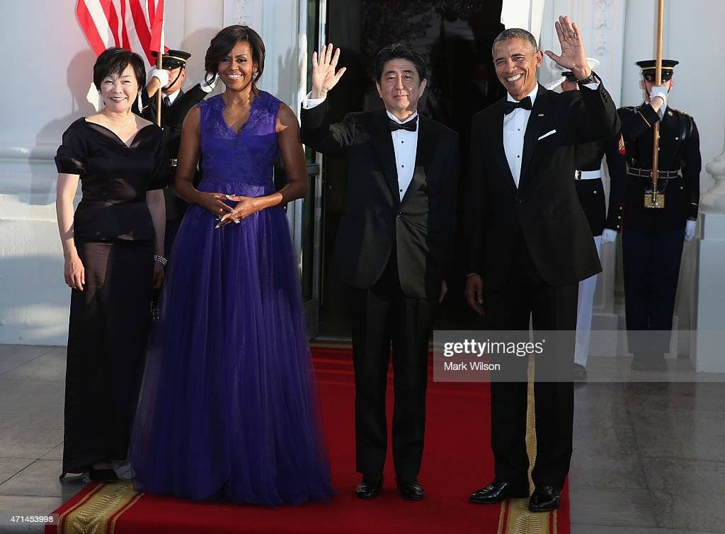 U.S .President <a gi-track='captionPersonalityLinkClicked' href=/galleries/search?phrase=Barack+Obama&family=editorial&specificpeople=203260 ng-click='$event.stopPropagation()'>Barack Obama</a> (R) and first lady <a gi-track='captionPersonalityLinkClicked' href=/galleries/search?phrase=Michelle+Obama&family=editorial&specificpeople=2528864 ng-click='$event.stopPropagation()'>Michelle Obama</a> (2nd L) welcome Japanese Prime Minister <a gi-track='captionPersonalityLinkClicked' href=/galleries/search?phrase=Shinzo+Abe&family=editorial&specificpeople=559017 ng-click='$event.stopPropagation()'>Shinzo Abe</a> and his wife <a gi-track='captionPersonalityLinkClicked' href=/galleries/search?phrase=Akie+Abe&family=editorial&specificpeople=2042808 ng-click='$event.stopPropagation()'>Akie Abe</a> after they arrived at the north portico of the White House April 28, 2015 in Washington, DC. President Obama is hosting a State Dinner the Japanese Prime Minister and his wife who are on an official visit to Washington.