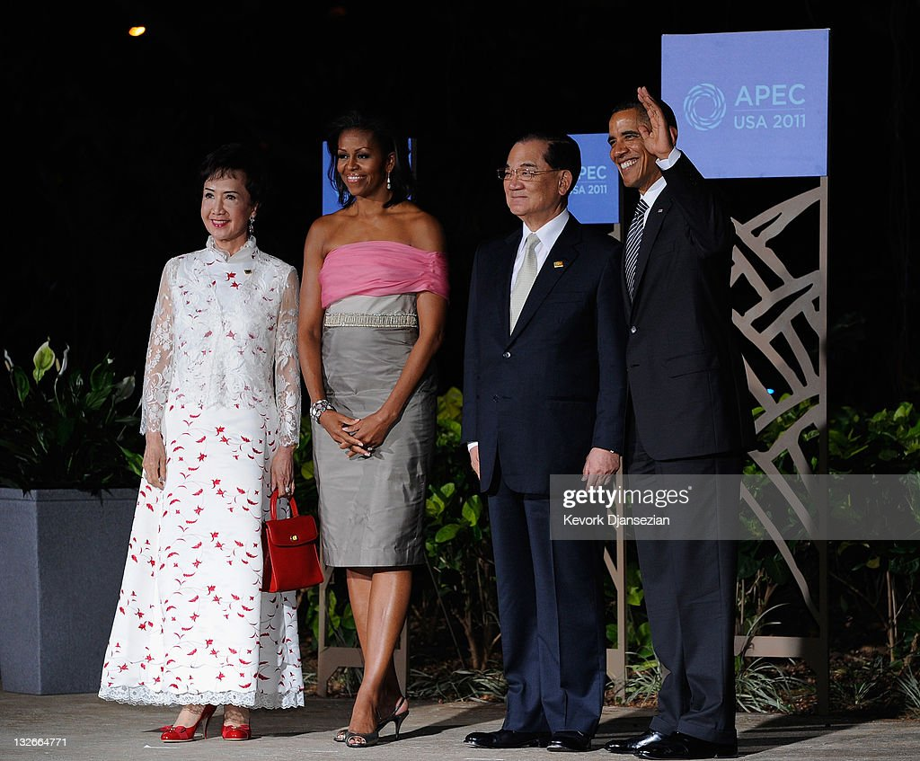 US President <a gi-track='captionPersonalityLinkClicked' href=/galleries/search?phrase=Barack+Obama&family=editorial&specificpeople=203260 ng-click='$event.stopPropagation()'>Barack Obama</a> ( R) and First lady <a gi-track='captionPersonalityLinkClicked' href=/galleries/search?phrase=Michelle+Obama&family=editorial&specificpeople=2528864 ng-click='$event.stopPropagation()'>Michelle Obama</a> (2ndL) welcome Taiwan's special envoy <a gi-track='captionPersonalityLinkClicked' href=/galleries/search?phrase=Lien+Chan&family=editorial&specificpeople=173452 ng-click='$event.stopPropagation()'>Lien Chan</a> and his wife Fang Yui at the the Asia-Pacific Economic Cooperation (APEC) summit dinner on November 12, 2011 in Waikiki, Hawaii. The United States hosted this year's APEC summit, with leaders from the 21 member economies convening on the island of Oahu.
