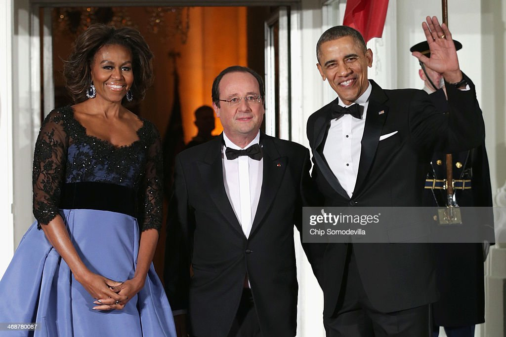 U.S. President <a gi-track='captionPersonalityLinkClicked' href=/galleries/search?phrase=Barack+Obama&family=editorial&specificpeople=203260 ng-click='$event.stopPropagation()'>Barack Obama</a> (R) and first lady <a gi-track='captionPersonalityLinkClicked' href=/galleries/search?phrase=Michelle+Obama&family=editorial&specificpeople=2528864 ng-click='$event.stopPropagation()'>Michelle Obama</a> welcomes French President Francois Hollande (C) during an official State Visit on the North Portico of the White House February 11, 2014 in Washington, DC. The two leaders held bilateral meetings, a joint press conference and will attend an official State Dinner.