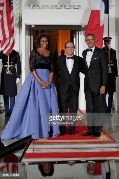 S President Barack Obama and first lady Michelle Obama welcomes French President Francois Hollande during an official State Visit on the North...