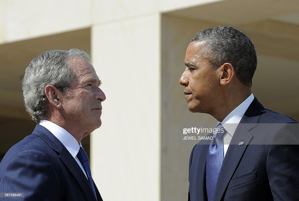 US President Barack Obama and former President George W Bush shakes hands during the opening ceremony of the George W Bush Presidential Center April...