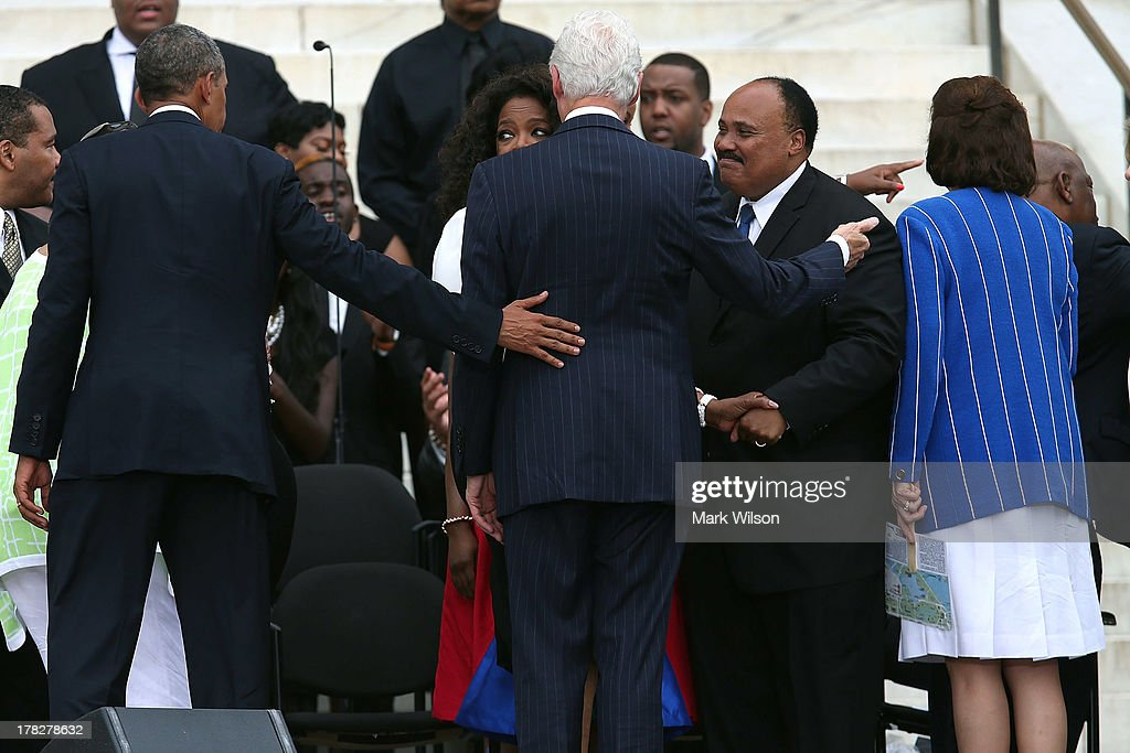 U.S. President Barack Obama (L) and former U.S. President Bill Clinton (C) greet Martin Luther King III (R) and other members of the King family during a ceremony to commemorate the 50th anniversary of the March on Washington for Jobs and Freedom August 28, 2013 in Washington, DC. It was 50 years ago today that Martin Luther King, Jr. delivered his 'I Have A Dream Speech' on the steps of the Lincoln Memorial.