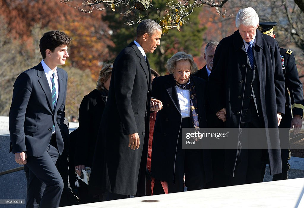 U.S. President Barack Obama (2nd L) and Former U.S. President Bill Clinton (R) help Ethel Kennedy (2nd R) up a set of steps as John 'Jack' Schlossberg (L) looks on before a wreath laying ceremony at the grave site for President John F. Kennedy at Arlington National Cemetery November 20, 2013 in Arlington, Virginia. The 50th anniversary of the assassination of John F. Kennedy will be marked on November 22.
