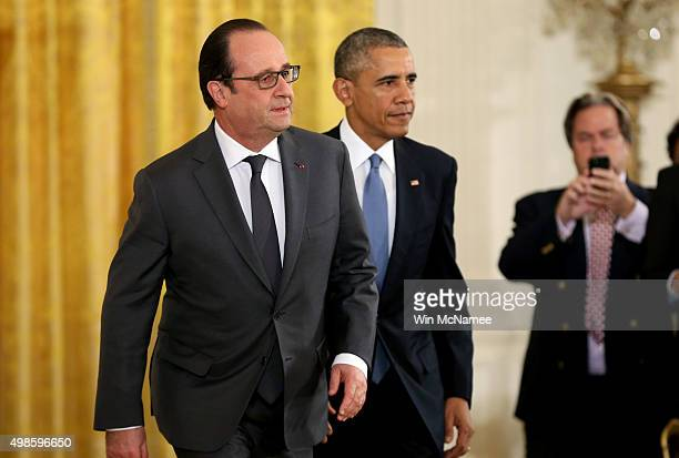 S President Barack Obama and French President Francois Hollande arrive for a joint press conference in the East Room of the White House on November...