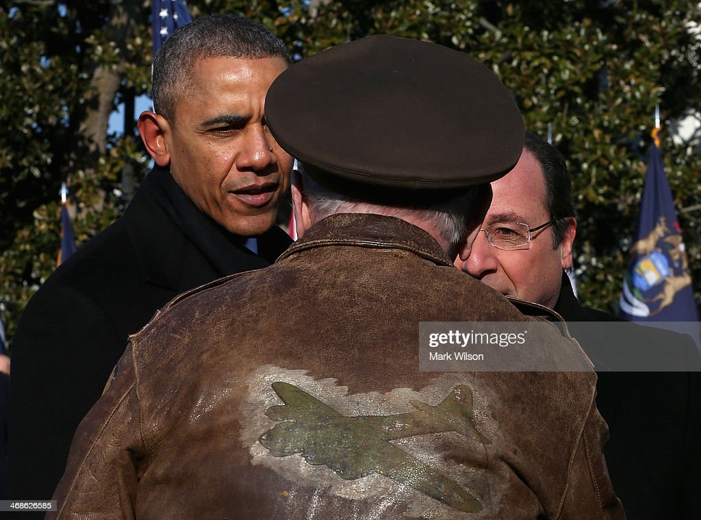 U.S. President <a gi-track='captionPersonalityLinkClicked' href=/galleries/search?phrase=Barack+Obama&family=editorial&specificpeople=203260 ng-click='$event.stopPropagation()'>Barack Obama</a> (L) and French President Francois Hollande (R) greet a military veteran during a welcoming ceremony on the South Lawn at the White House on February 11, 2014 in Washington, DC. Hollande who arrived yesterday for a three day state visit, visited Thomas Jefferson's Monticello estate and will be the guest of honor for a state dinner tonight.