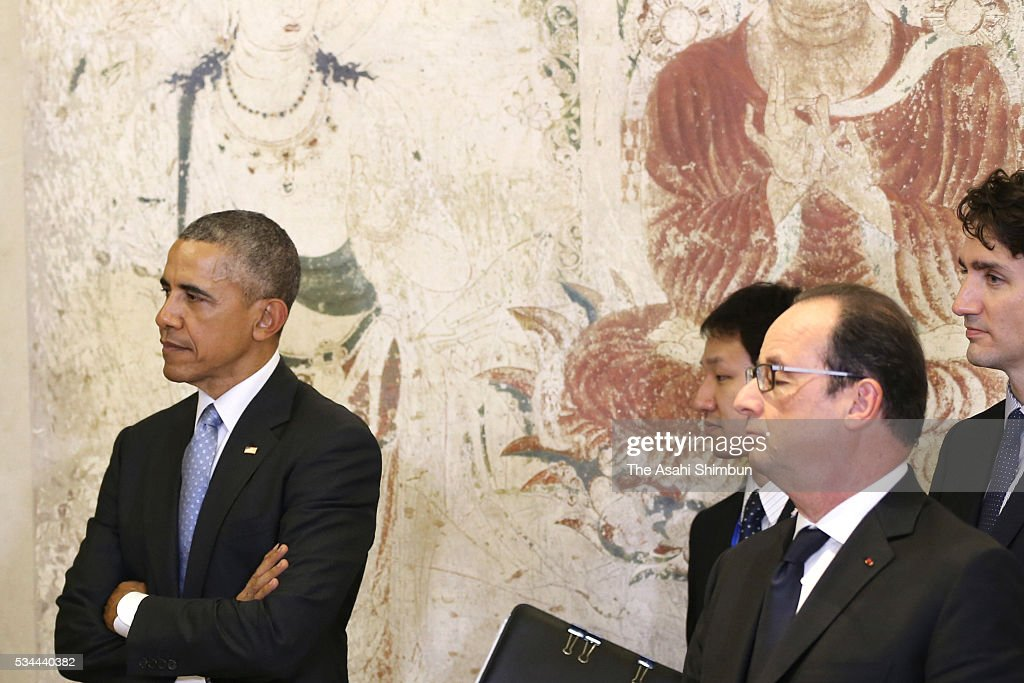 U.S. President Barack Obama (1st L) and French President Francois Hollande stand in front of the reproduced mural of the Horyuji Temple at the Exhibitions about anti-terrorism and the conservation of cultural properties prior to the working dinner during the Group of Seven summit on May 26, 2016 in Shima, Mie, Japan. The 2-day Group of Seven summit takes place to discuss key global issues such as global economy and counter terrorism measures.